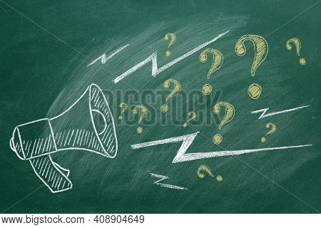 Megaphone With Question Marks Hand Drawn In Chalk On A Green Chalkboard. Ask For Help. Faq Concept.