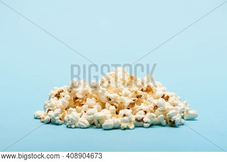 Pile Of Crunchy Airy Popcorn On Blue With Copy Space, Cinema Concept.