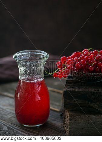 Glass Jar Of Red Currant Soda Drink On Dark Wooden Table. Summer Healthy Detox Lemonade, Cocktail Or