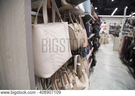 A Store That Sells Bags. Bags On The Counter Of The Store.