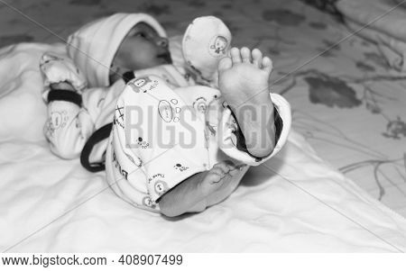 Closeup Image Of Cute Beautiful Adorable Baby Boy Foot Posing On Playing Mood In Winter Clothing Lyi