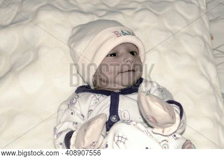 Closeup Portrait Image Of Cute Beautiful Adorable Baby Boy Asian And Indian Ethnicity In Winter Clot