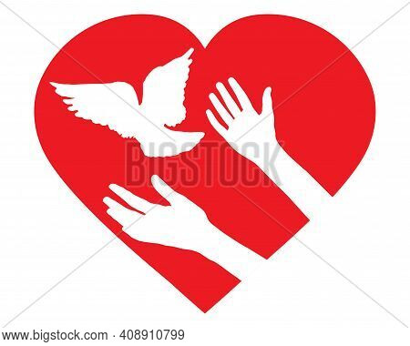 Female Hands Let Bird Go Free And Pigeon Flies, In Shape Of Heart. Concept Of Peace, Hope, Love And