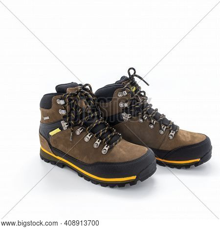 Trekking Boots In Brown Nubuck And Black Vinyl. Metal Lace Hardware, Yellow Trim, Grooved Sole. Isol
