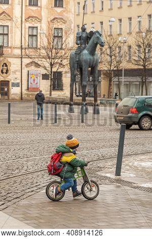 Brno, Czech Republic. 02-17-2021. Child On Bike With The Horse Statue Made By Czech Artist Jarosla R