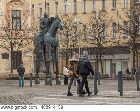 Brno, Czech Republic. 02-17-2021. Young Couple Holding Hands With The Horse Statue Made By Czech Art