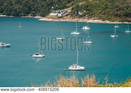 Phuket, Thailand - May 15, 2020: Sailing Yachts And Catamarans Are Parked At The Harbor At Nai Harn