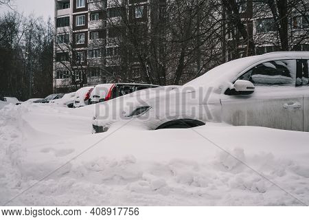 Moscow, Russia - February 14 2021: The Yard Of A Residential Building. A Row Of Snow-covered Cars Af