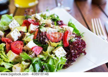 Greek Mediterranean Salad With Feta Cheese, Tomatoes And Peppers. Mediterranean Salad. Greek Cuisine