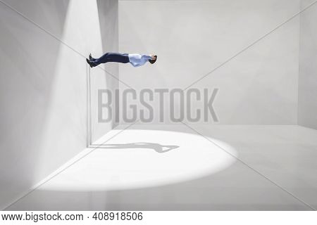 Man Walking On Wall Inside A White Room . Escape And Confusion Concept . This Is A 3d Render Illustr
