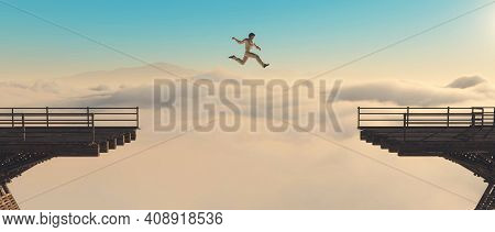 Man Jumps Over Gap Of A Bridge At High Altitude Above Clouds . Overcoming Problems And Motivation Co