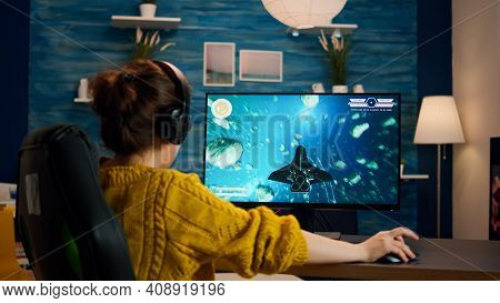 Expert Woman Gamer Playing Space Shooter Video Game On Powerful Pc. Virtual Shooter Game Championshi
