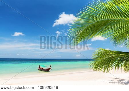 Thai Traditional Wooden Longtail Boat And Beautiful Sand Beach In Koh Tao, Thailand.