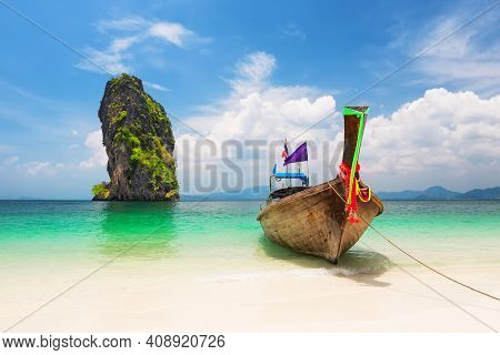 Thai Traditional Wooden Longtail Boat And Beautiful Sand Beach At Koh Poda Island In Krabi Province.