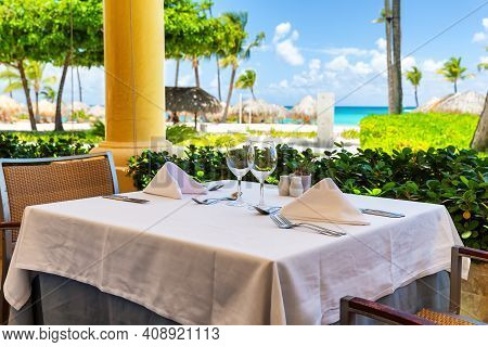Outdoor Restaurant At The White Sand Beach In Luxery Hotel In Punta Cana, Dominican Republic.  Beaut