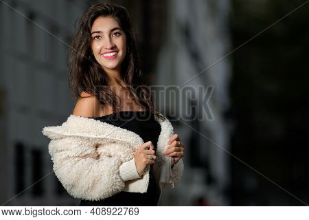 Portrait Of A Young Parisian Woman With A Beautiful Smile