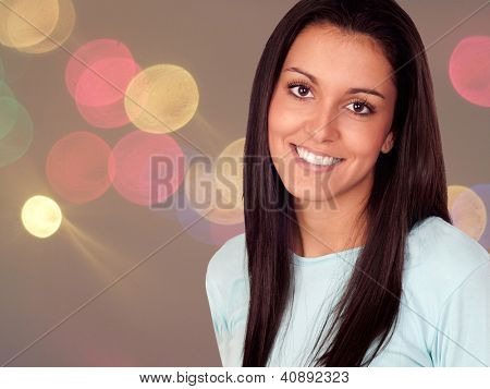 Pretty brunette woman with long hair in the nighclub