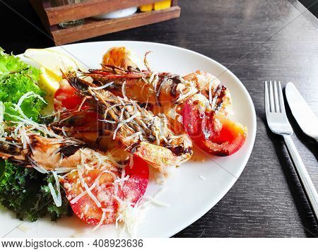 Fried Roasted Shrimps In Plate With Lemon And Green Salat.