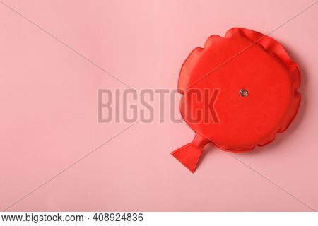 Whoopee Cushion On Pink Background, Top View. Space For Text