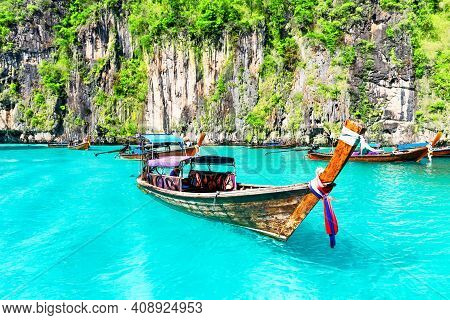 Famous Maya Bay Lagoon At Ko Phi Phi Leh Island With Thai Traditional Longtail Boat, Surrounded By L