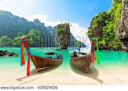 Famous James Bond Island Near Phuket In Thailand. Travel Photo Of James Bond Island With Thai Tradit
