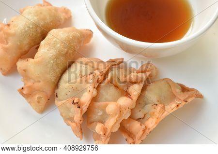 Crispy Fried Gyoza Or Japanese Dumpling Stuffed Mashed Pork Dipping Shoyu Sauce On Plate