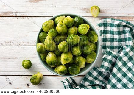 Set Of Brussel Sprouts In A Bowl On Wooden Table. Top View