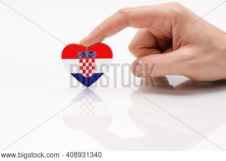 Croatia Flag. Love And Respect Croatia. A Man's Hand Holds A Heart In The Shape Of The Croatia Flag