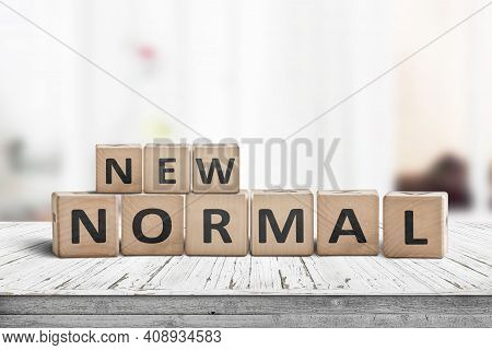 New Normal Lifestyle Sign On A White Table In A Bright Living Area Of The Future