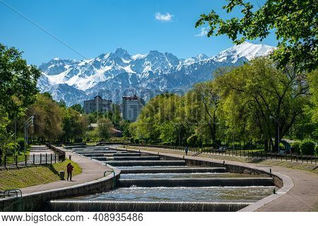 Almaty, Kazakhstan - May 5, 2019: Morning On The Esentai River Vesnovka Overlooking The Snow-capped
