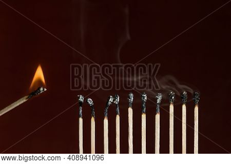 Burn Out Matches In A Row With One Lit Match Next As A Cause Of Ignition. Concept Of Ignition And Bu