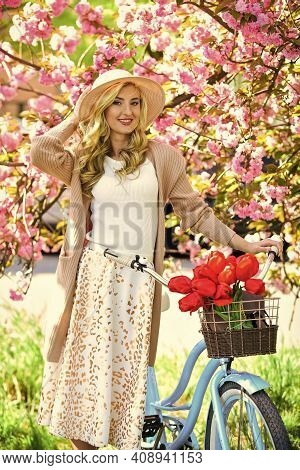 Enjoying Spring Day. Fashion Woman Enjoy Spring Nature. Spring Blooming Tree Of Sakura. Cherry Beaut