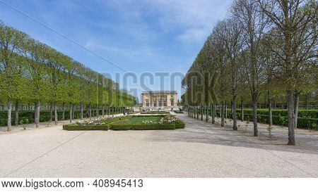 Versailles, France - May 2019 Green Alley Leading To The Castle. Little Trianon Is A Neoclassical Ca
