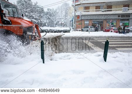 Athens, Greece-february 16th, 2021: Cleaning A Snowy Road With A Special Snowplow Machine In The Ath