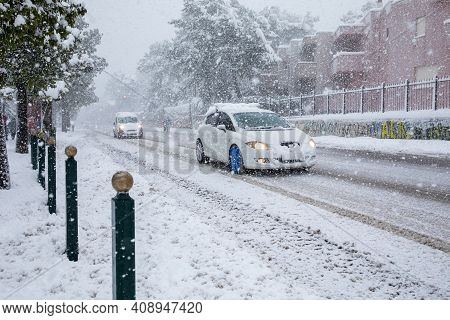 Dangerous Driving In A Snowstorm Through The Snowy Streets Of The Athens City, Greece, 16th Of Febru