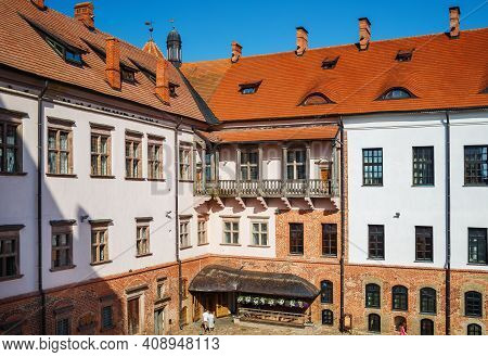 Mir, Belarus - August 11, 2017: Facade Of Ancient Building, Balcony And Windows In Ancient Medieval