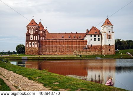 Mir, Belarus - August 04, 2017: Ancient Medieval Fortress On The Shore Of The Lake. Architectural Mo