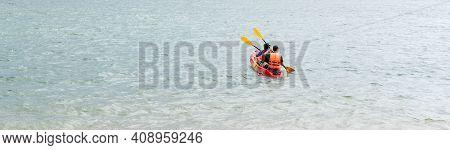 Rear View Of Kayaker Men Paddle Kayak At Sunset Sea. Kayaking, Canoeing, Paddling