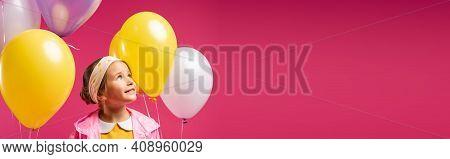 Happy Kid Looking Away Near Balloons Isolated On Crimson, Banner.