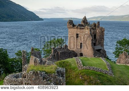 Ancient Tower Of Urquhart Castle In Late Afternoon Near Drumnadrochit City In Scotland Highlands, Uk