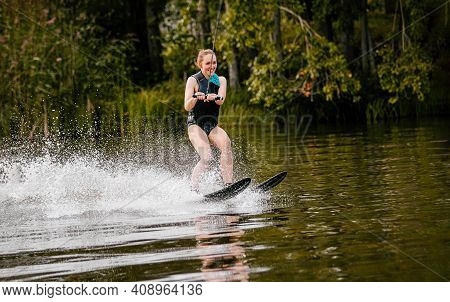 Smiling Woman On Water Skiing In Life Jacket