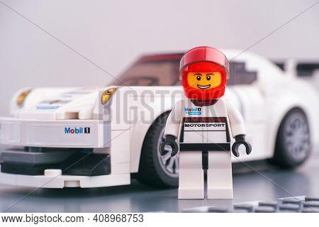 Tambov, Russian Federation - February 14, 2021 Lego Porsche Driver Against White Porsche 911 Gt Race