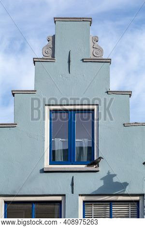 Colroful Gable House With Blue Windows And Door And Colroful Light Blue Wall