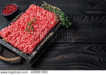 Raw Mince Ground Beef And Pork Meat In A Wooden Tray With Herbs. Black Background. Top View. Copy Sp