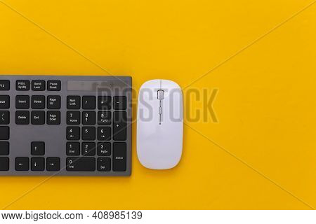 Pc Keyboard With Pc Mouse On Yellow Background. Top View