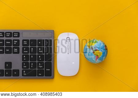 Global Web. Pc Keyboard With Pc Mouse, Globe On Yellow Background. Top View