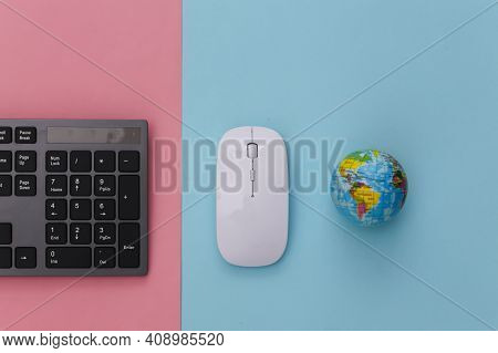Global Web. Pc Keyboard With Pc Mouse, Globe On Pink Blue Pastel Background. Top View