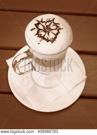 Latte Macchiato With Cocoa Powder In The Form Of Flower