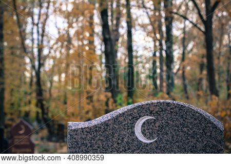 Traditional Islamic Crescent Moon Symbol On Granite Gravestone. Muslim Grave In The Autumn Cemetery