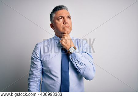 Middle age handsome grey-haired business man wearing elegant shirt and tie Touching painful neck, sore throat for flu, clod and infection